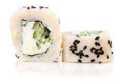 White fish, cream cheese, black sesame seeds and cucumber sushi Stock Photo