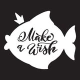 White fish with crown and calligraphic make a wish inscription on black background. Vector hand drawn banner with lettering Royalty Free Stock Image