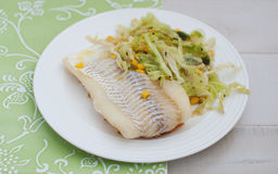 White fish fillet with salad Stock Image