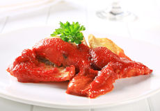 White fish fillets with tomato sauce Stock Images
