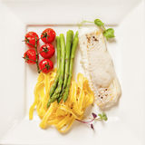 White fish with foam, tagliatelle and green asparagus Royalty Free Stock Photos
