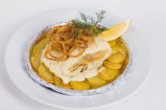 White fish with potatoes, fried onions, dill Stock Image