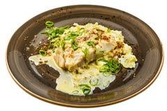 White fish in sauce Stock Image