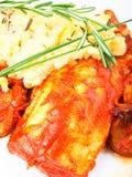 White fish with tomato sauce Royalty Free Stock Photos