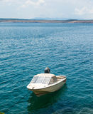 White fishing boat moored in Adriatic sea water Royalty Free Stock Images