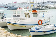 white fishing boat in the port of Heraklion stock photography