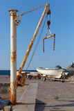 White fishing boat and small crane in port. Of Petrovac town, Montenegro Royalty Free Stock Photography