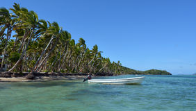 White fishing boat on a tropical island in Fiji Royalty Free Stock Photography