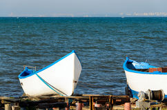 White fishing boats. Against blue clear sea, big lake or ocean Stock Images