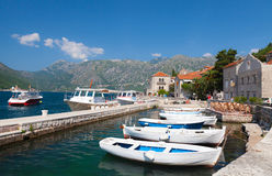 White fishing boats float moored in Perast. Kotor Bay, Montenegro royalty free stock photography