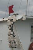 White fishing buoys fender japanese white tug detail. Fishing buoys white detail on japanese tug red flag Stock Images