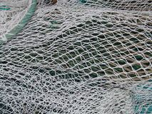 White Fishing Net Display Textured Background. Photography Royalty Free Stock Photo