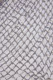 White fishing net white wall. White fishing net against white wall background texture marine style royalty free stock photos