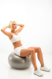 White fitness woman exercise on silver ball Stock Photos