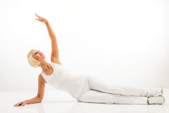 White fitness woman stretch body at Pilates Stock Image