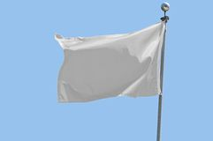 White Flag. Flying in a stiff breeze against a clear blue sky