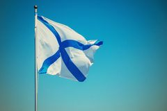 White flag with blue cross flies on a flagstaff Stock Images