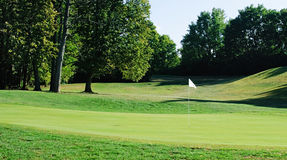 White Flag on Golf Course. White flag on green of golf course Royalty Free Stock Images