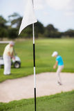 White flag at golf course Royalty Free Stock Photography