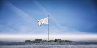 White flag standing on ground Royalty Free Stock Photography