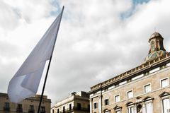 White flag in front of a public building royalty free stock photography