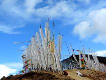 White flags as per Bhutanese customs. As per the Bhutanese tradition, white flags are hoisted in the memory of the dead family members so that their souls rest Royalty Free Stock Photography