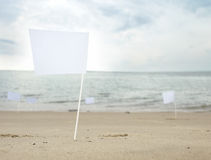 A white flags at the beach Royalty Free Stock Photo