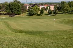 White Flagstick in Green Golf Course in Sunny Day.  Stock Photo