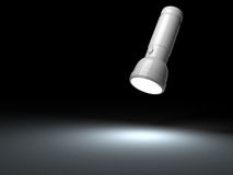 White flashlight lighting on black surface Royalty Free Stock Photos