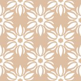 White floral ornament on beige background. Seamless pattern. White floral design on beige background. Seamless pattern for textile and wallpapers Stock Photos