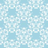 White floral seamless design on blue background. White floral design on blue background. Seamless pattern for textile and wallpapers Stock Images
