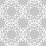 White floral seamless design on gray background. White floral design on gray background. Seamless pattern for textile and wallpapers Royalty Free Stock Photo