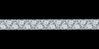 White floral lace band. Over black background royalty free stock images
