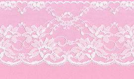 White floral lace on a pink background Royalty Free Stock Photo