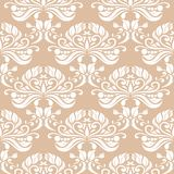 White floral seamless pattern on beige background. White floral ornament on beige background. Seamless pattern for textile and wallpapers Royalty Free Stock Photos