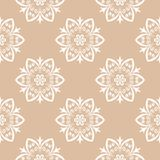 White floral ornament on beige background. Seamless pattern. White floral design on beige background. Seamless pattern for textile and wallpapers Royalty Free Stock Photos