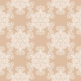 White floral ornament on beige background. Seamless pattern. White floral design on beige background. Seamless pattern for textile and wallpapers Stock Photo