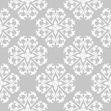 White floral seamless pattern on gray background. White floral ornament on gray background. Seamless pattern for textile and wallpapers Royalty Free Stock Image