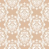 White floral pattern on beige seamless background. White floral ornament on beige seamless background. Seamless pattern for textile and wallpapers Stock Photo