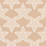 White floral pattern on beige seamless background. White floral ornament on beige seamless background. Seamless pattern for textile and wallpapers Royalty Free Stock Photography