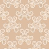 White floral pattern on beige seamless background. White floral ornament on beige seamless background. Seamless pattern for textile and wallpapers Royalty Free Stock Photo