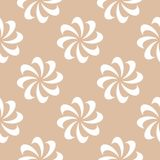 White floral seamless design on beige background. White floral ornamental design on beige background. Seamless pattern for textile and wallpapers Stock Photography