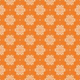 White floral seamless pattern on orange background. White floral ornament on orange background. Seamless pattern for textile and wallpapers Stock Photo