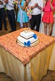 White floral wedding cake on restaurant interior background Royalty Free Stock Image