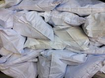 White flour bag arranged in a raw material warehouse. Flour ingredients bag in food production, business Transportation or manufacturing concept and food supply royalty free stock photo