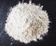 White flour on black backgorund texture Stock Photography