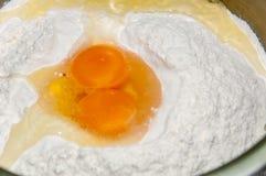 White flour in the bowl with egg yolk Stock Photo