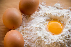 White flour and eggs on the table Royalty Free Stock Photography