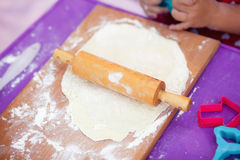 White flour on a table creating and little girl's Royalty Free Stock Photos