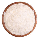 White flour in a wooden bowl on a white Stock Photo